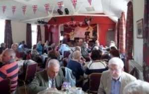 Lunch in the village hall, deservedly popular - music and food? Play on